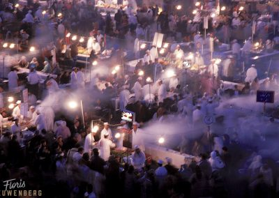 The lights at El Fna shine through the smoke produced from all the food squares ,Marrakesh, Morocco