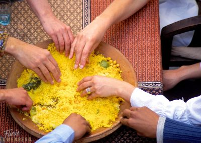 Moroccan tagine being shared with friends.