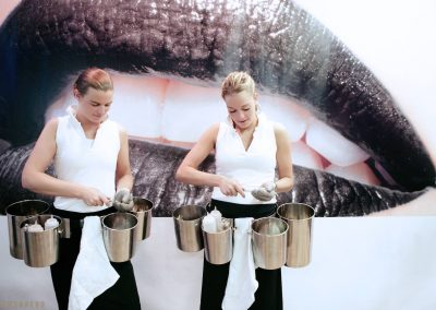 Hostesses preparing an oyster treat at the Millionaire fair